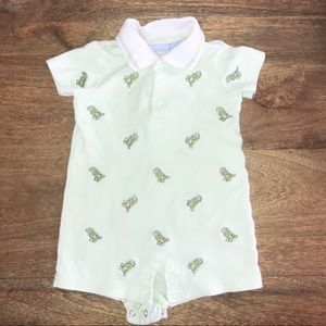 Light green dinosaur onesie.